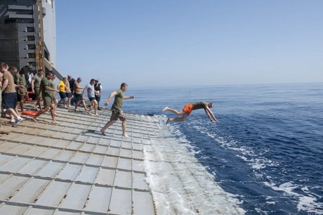 sailors-and-marines-aboard-the-uss-fort-mchenry-jump-off-the-stern-gate-into-the-mediterranean-sea.jpg